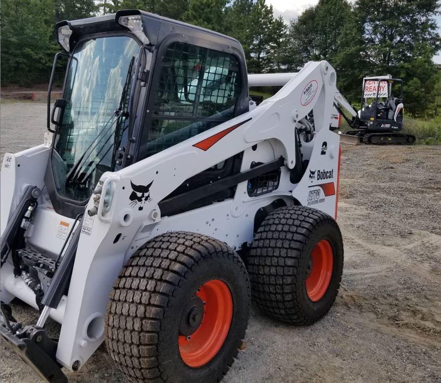 kansas city tree services bobcat loader for trtee removal